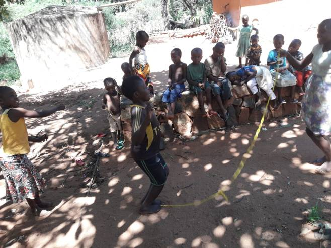 The children skipping rope.